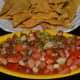 Fresh tomato-red onion salsa with home made nacho chips