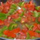 Step four: Add chopped capsicum and tomato. See that tomato does not become mushy.