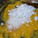 Step five: Add sugar, grated coconut, cardamom powder, and salt. Mix well.