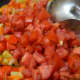 Step seven: Add tomatoes and continue to cook.