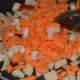 Step five: Throw in chopped potato and carrots. Stir-cook for 3 minutes. Add salt for fast cooking.
