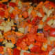 Step six: Add chopped red capsicum. Continue stir-cooking for a while.
