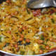 Step nine: Ensure the fine mixing of the spices and seasonings with the rice flakes. Poha chivda is ready to munch.