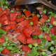 Step five: Add chopped tomatoes. Continue stir-cooking till tomatoes become soft and not mushy.
