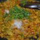 Step ten: Add some chopped coriander leaves and mix. Stir-cook for two minutes. Transfer the curry into a serving dish.