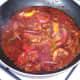 Vindaloo sauce is gently simmered