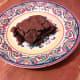 Let the brownie cool in the pan or eat it warm. Just don't burn your fingers. Add the powdered sugar if you'd like. Now look at this delicious masterpiece. Omg!!! Yes!! Eat that delicious brownie and enjoy!