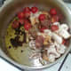 Tomato and mushroom sauce ingredients are added to a saucepan