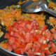 Step 5: Add chopped tomatoes.