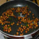 Throw in cooked chickpeas. Add sugar and very little salt. Mix well.