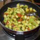 Stir-cooking the mixture.