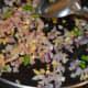 Step six: Add chopped onions. Saute till they become transparent. Add salt. Mix well.