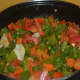 Step five: Stir-cook them, sprinkling some water till they become tender yet crunchy. Throw in tomatoes. Cook till they wilt. By this time, the contents turn almost dry.