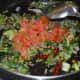 Step four: Add chopped tomatoes. Stir-cook till tomatoes turn a bit mushy.