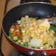 Step three: Add corn kernels and butter.