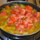Step four: Add chopped tomatoes. Stir once. Continue cooking, covered, for another 5 to 6 minutes. Stir the mix occasionally.