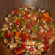 Sauté all the veggies together, then add the browned beef cubes, stock, wine, and herbs.