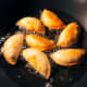 Fry the curry puffs with a generous amount of oil to make sure they cook evenly.