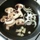 Starting to saute mushrooms, garlic and onion