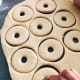 Shape the donut with a donut cutter.
