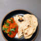 Chicken tikka masala with naan bread.