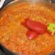 Adding tomato paste,