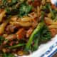 Rice Drops in Dongcai Mushroom Pork sauce. Italian rape as green leafy vegetable.