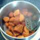 Mashing sweet potatoes and carrot