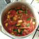 Vegetables in spicy tomato sauce are brought to a simmer