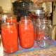 When finished, pour the sauce into pre-warmed canning jars.