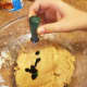 Add a generous amount of green food coloring to the cookie dough.