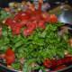 Step 2: Throw in chopped green leafy veggies, chopped tomatoes, sugar, and salt.