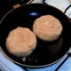 Fishcakes are put on to fry