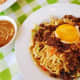 """Pancit batil patong: Miki noodles, carabeef meat, and bean sprouts, topped with fried egg and often served with a small bowl of egg-drop soup (hence the names """"batil"""" and """"patong""""). Comes from Tuguegarao, Philippines."""