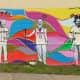 "The ""New Art Era"" mural on Polk Street near the ""We Love Houston"" sculpture by David Adickes"