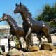 Horse sculptures in yard space in front of the restaurant