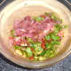 Chopped bacon is added to salad