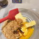 In a large bowl, combine the brown sugar, butter, egg yolk, and vanilla essence. Use a spatula to mix the ingredients.