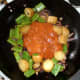 Jalfrezi sauce is added to stir fried vegetables