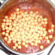 Chickpeas are added to curry sauce