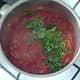 Coriander/cilantro is added to tomato sauce