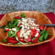 Add the sliced almonds to the salad, then gently combine the ingredients together.