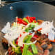 Stir in all the vegetables and let them cook for about 2 minutes.