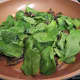 Adding the baby spinach to the pan