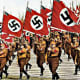 A Nuremburg rally. By 1930 when this photo was taken, the swastika flag was everywhere in Nazi news reels - it had became a symbol for everything they stood for. The notoriety could only grow