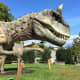 Carnotaurus with Amargasaurus in the background