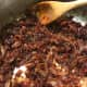 Continue cooking and stirring occasionally for up to 3 hours. You're looking for the bacon jam to turn a nice dark, chocolate brown color. Be careful as the last of the liquid evaporates. You don't want to burn it at the end, and it can happen fast!