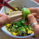 Fresh lime adds zest and brightness. Squeeze the lime juice directly into the salsa.
