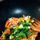 Add the carrots and green bell pepper into the mixture.