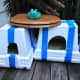These cat shelters are super simple and made out of just Styrofoam and straw.